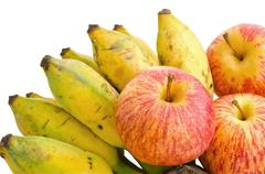 Bunch of cultivated banana and apples Stock Photos