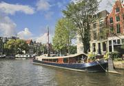 Stock Photo of Netherlands, Amsterdam, View of houseboat at the bank of amstel canal