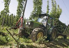 Germany, Farm machine harvesting hops Stock Photos