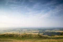 View across english countryside landscape during late summer evening with dra Stock Photos