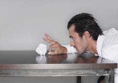Business man tossing crumpled paper ball Stock Photos