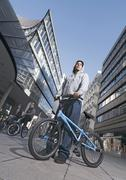 Stock Photo of Germany, Stuttgart, Young men with BMX bike in city