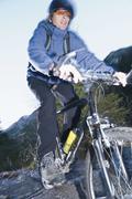 Austria, Man riding mountain bike - stock photo