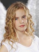 Portrait of girl as angel, close up - stock photo