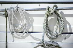 detail image of ropes and cleats on yacht sailboat - stock photo