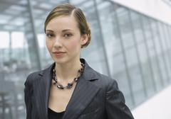 Romania, Young woman in office, portrait - stock photo