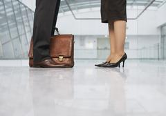 Stock Photo of Business people standing on shiny floor