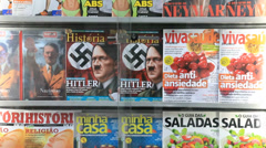 Nazi propaganda on display, side by side with food, sport, fashion magazines Stock Footage