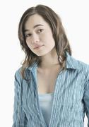 Teenage girl in blue blouse, portrait Stock Photos
