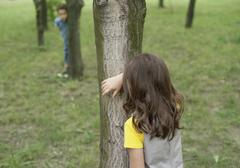 Romania, Children playing hide and seek - stock photo