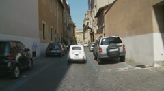 Fiat 500 traveling through back streets of Rome (slomo) Stock Footage