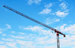 building crane and blue sky - stock photo