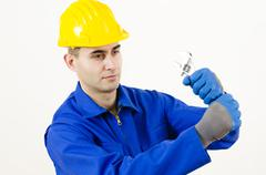 man holding adjustable wrench - stock photo