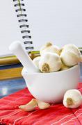 Garlic in a bowl Stock Photos