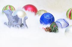 Christmas balls and a sledge Stock Photos