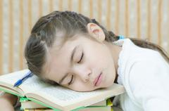 a little school girl sleeping - stock photo