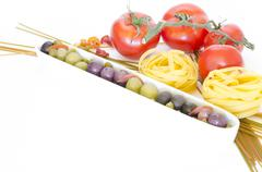 Composition of pasta and tomatos Stock Photos