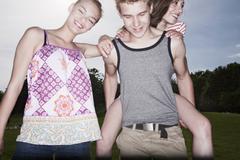 Germany, Berlin, Teenage girls and boy smiling Stock Photos