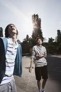 Germany, Berlin, Teenage boys standing in playground, looking up - stock photo