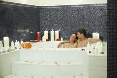Stock Photo of Couple having romantic bath in hotel urthaler