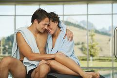 Couple on sun lounger in hotel urthaler - stock photo