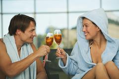 Couple enjoying drink in hotel urthaler - stock photo