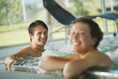 Couple in swimming pool of hotel urthaler Stock Photos