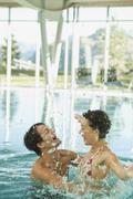 Couple enjoying in swimming pool of hotel urthaler - stock photo
