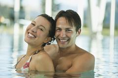 Couple in swimming pool of hotel urthaler - stock photo