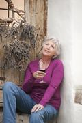 Italy, South Tyrol, Mature woman with wine glass - stock photo