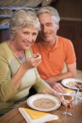 Stock Photo of Mature couple having their snacks at guesthouse, smiling, portrait