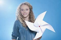 Girl holding paper windmill, portrait Stock Photos