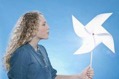 Girl holding paper windmill Stock Photos