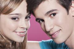 Teenage girl and boy smiling, portrait - stock photo