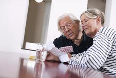 Stock Photo of Germany, Wakendorf, Senior couple with medicine