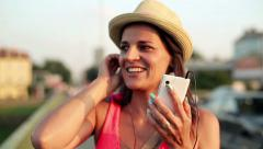 Young woman talking on cellphone by the street HD - stock footage