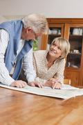 Germany, Kratzeburg, Senior couple reading map - stock photo