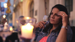 Lonely sad woman with empty wine glass sitting in cafe HD Stock Footage