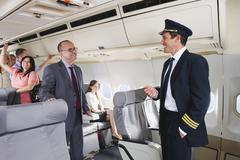 Germany, Bavaria, Munich, Flight captain and passengers in business class Stock Photos