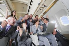 Germany, Bavaria, Munich, Group of passengers looking in laptop in business - stock photo