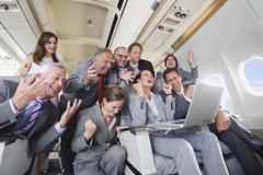 Germany, Bavaria, Munich, Group of passengers looking in laptop in business Stock Photos