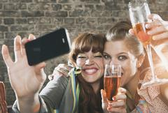 Germany, Berlin, Close up of young women holding champagne glass and Stock Photos