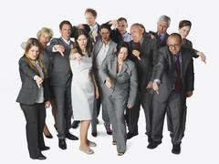 Large group of business people showing thumbs down against white background Stock Photos