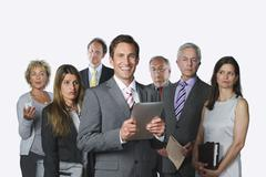 Stock Photo of Business people with digital tablet, file, diary, mobile phone and newspaper