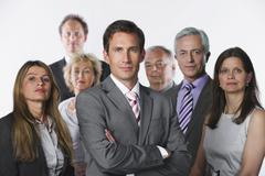 Stock Photo of Business people against white background, smiling, portrait