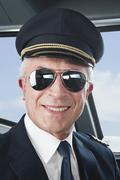 Germany, Bavaria, Munich, Senior flight captain wearing aviation glasses in - stock photo
