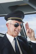 Germany, Bavaria, Munich, Senior flight captain wearing aviation glasses and - stock photo