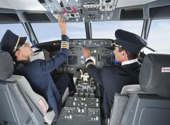 Germany, Bavaria, Munich, Pilot and co-pilot piloting aeroplane from airplane - stock photo