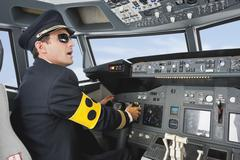 Stock Photo of Germany, Bavaria, Munich, Pilot with armlet for blind piloting aeroplane from