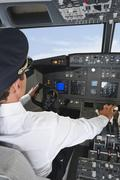 Stock Photo of Germany, Bavaria, Munich, Pilot piloting aeroplane from airplane cockpit